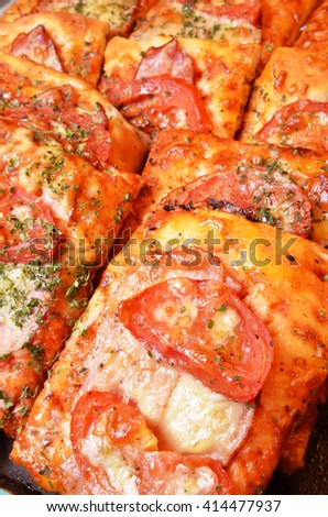 Pizza breads with chess and tomatos at the bakery    - stock photo