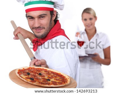 pizza cook and a waitress - stock photo