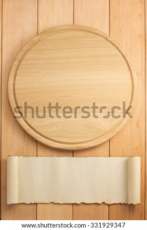 pizza cutting board on wooden background - stock photo