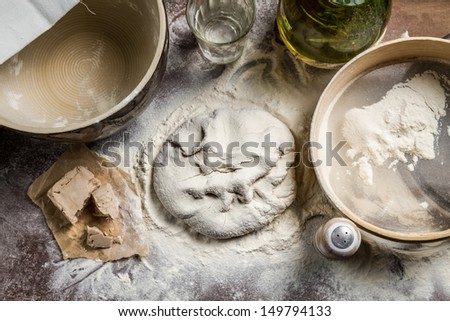 Pizza dough made from yeast and flour - stock photo