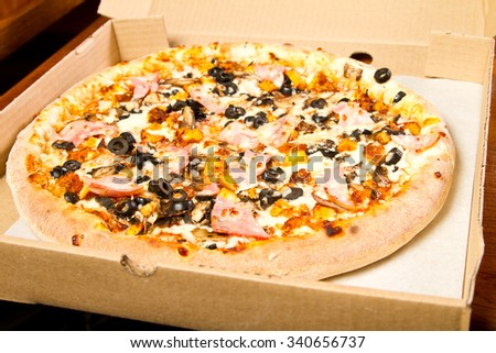 Pizza in a delivery box - stock photo