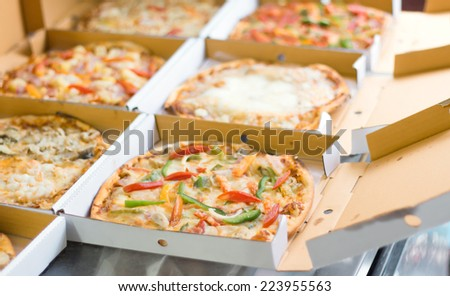 Pizza in box at the kitchen  - stock photo