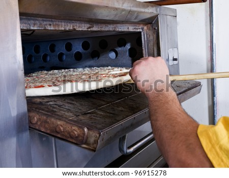 Pizza Making checking the crust - stock photo