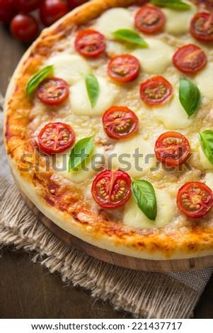 Pizza Margherita (mozzarella, tomato, basil) close up - stock photo