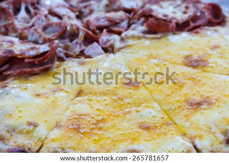 Pizza Meat lover with sausage, salami, ham, bacon, pepperoni and cheese in restaurant. - stock photo