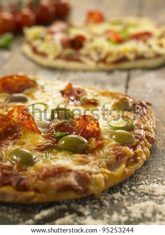 pizza on a rustic wooden table - stock photo