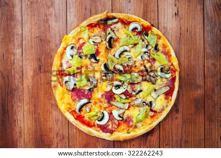 pizza on wood background - stock photo