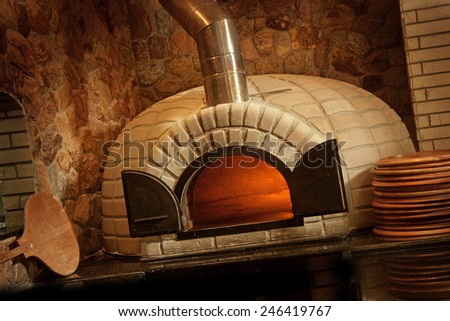 PIZZA OVEN 2 - A lit stone baked pizza oven - stock photo