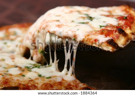Pizza slice-lifted with cheese strings - stock photo