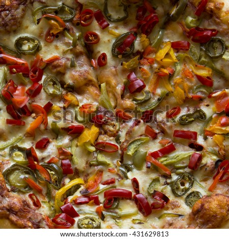 Pizza topped with Peppers - stock photo