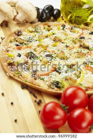 Pizza vegetarian with eggplant, olives, tomatoes, parmesan - stock photo