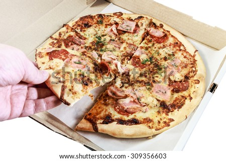 Pizza with bacon in box on a white background. Focus on the most pizza in a box - stock photo
