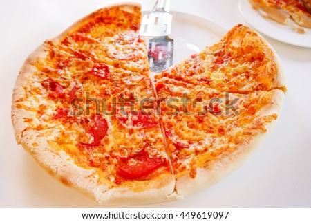 Pizza with baked ingredients - cheese with ham and tomatoes. Traditional italian cuisine. - stock photo