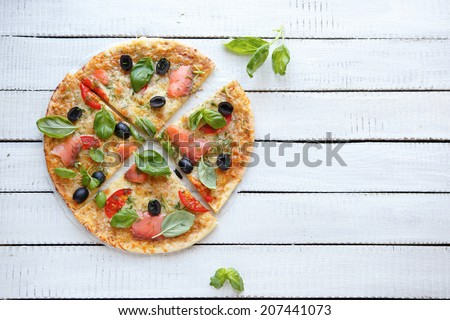 pizza with cheese, smoked salmon and olives, top view - stock photo