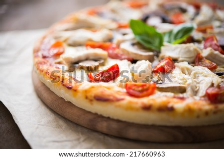 Pizza with chicken, tomato and mushrooms close up - stock photo