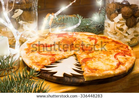 pizza with Christmas decorations - stock photo