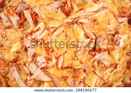 Pizza with ham, chicken and pineapple close-up, selective focus, macro. Italian cuisine - stock photo