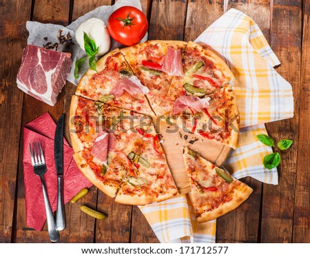 Pizza with jerky beef, feta and pickled cucumbers - stock photo