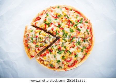 Pizza with mozzarella cheese, chicken, sweet corn, sweet pepper and parsley on white background top view. Italian cuisine. - stock photo