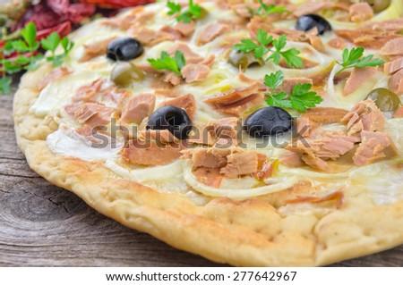 Pizza with Mozzarella, Tuna, Onions and Olives - stock photo