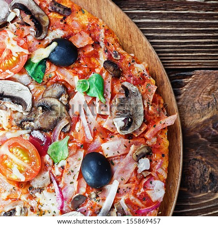 pizza with mushrooms and cheese on the table - stock photo