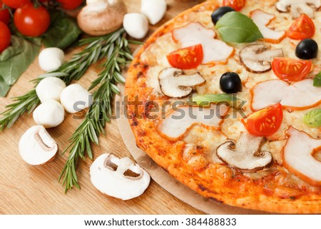 Pizza with mushrooms and vegetables - stock photo