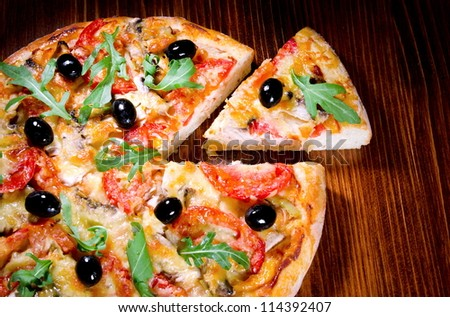 pizza with mushrooms, tomatoes, olives - stock photo
