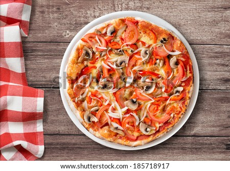 pizza with paprika and mushrooms top view on table with picnic tablecloth - stock photo
