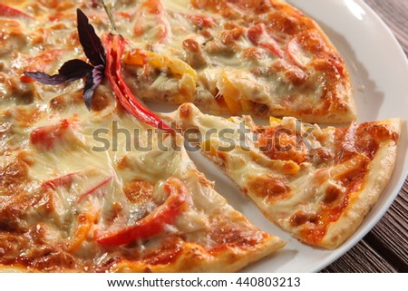 Pizza with pepper on white plate - stock photo