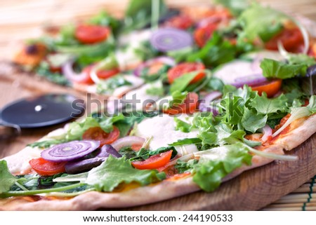 Pizza with salad and onion - stock photo