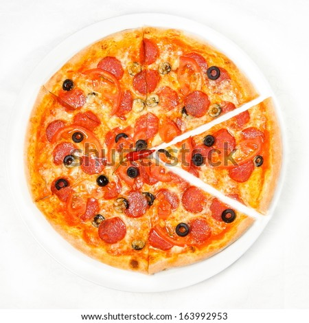 pizza with salami - stock photo