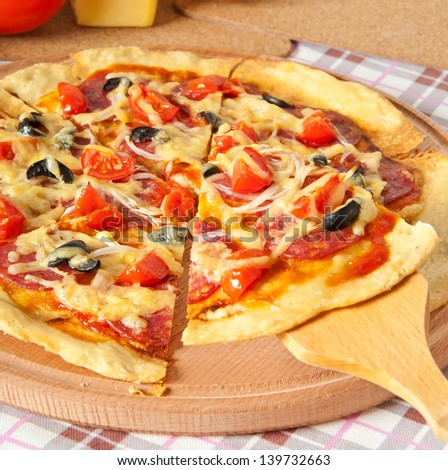 pizza with salami and tomatoes - stock photo