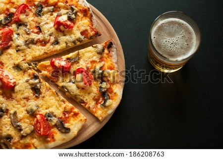 pizza with tomatoes and champignons - stock photo