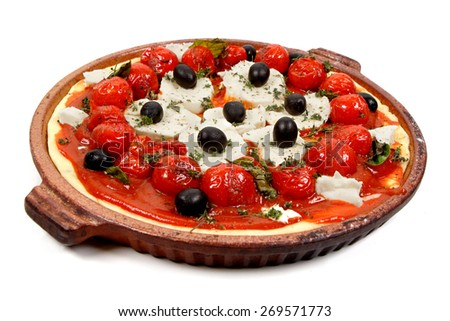 Pizza with tomatoes, black olive and goat cheese - stock photo