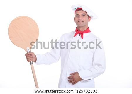 Pizzaiolo showing his shovel - stock photo