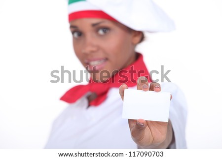 Pizzeria chef holding business card - stock photo