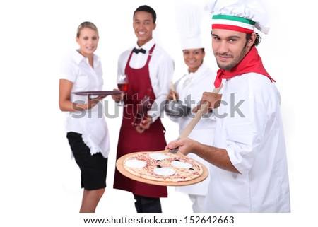 Pizzeria team. - stock photo