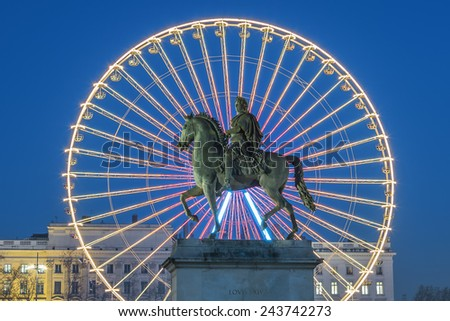 Place Bellecour statue of King Louis XIV by night, Lyon France  - stock photo