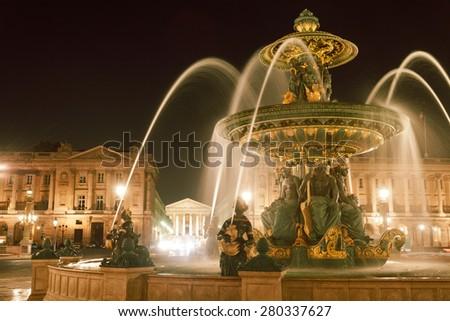 Place de la Concorde by night, close up of the fountains, Paris - stock photo