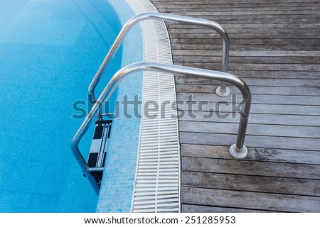 Place descent into the pool. Railings and stair. - stock photo