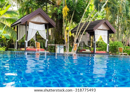 Place for Thai massage at beautiful swimming pool in tropical resort, Koh Chang island, Thailand. - stock photo