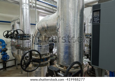 Place in a large industrial boiler room. - stock photo