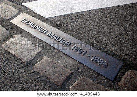 Place of the Berlin wall until 1989, now part of a street. - stock photo