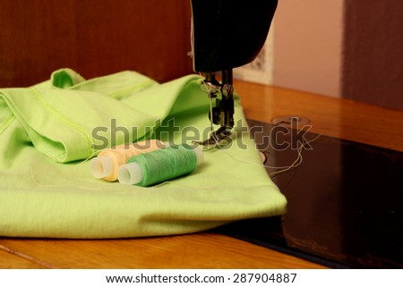 Place seamstresses. Sewing machine, fabric and thread for sewing - stock photo