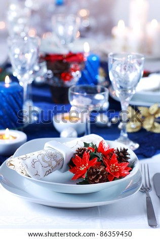 Place setting for Christmas in blue and white tone - stock photo
