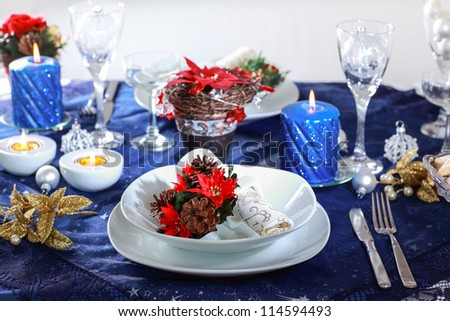 Place setting for Christmas in blue tone - stock photo