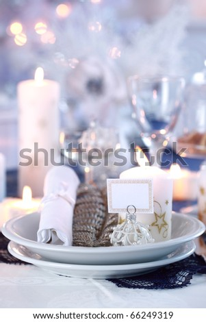 Place setting for Christmas in white - stock photo