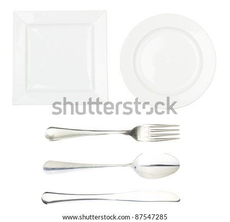 Place setting with high-gloss plate, spoon, knife & fork. Isolated on white. - stock photo