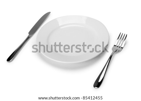 Place setting with plate, knife and fork - stock photo