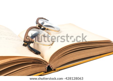 Place the glasses on an old book - stock photo